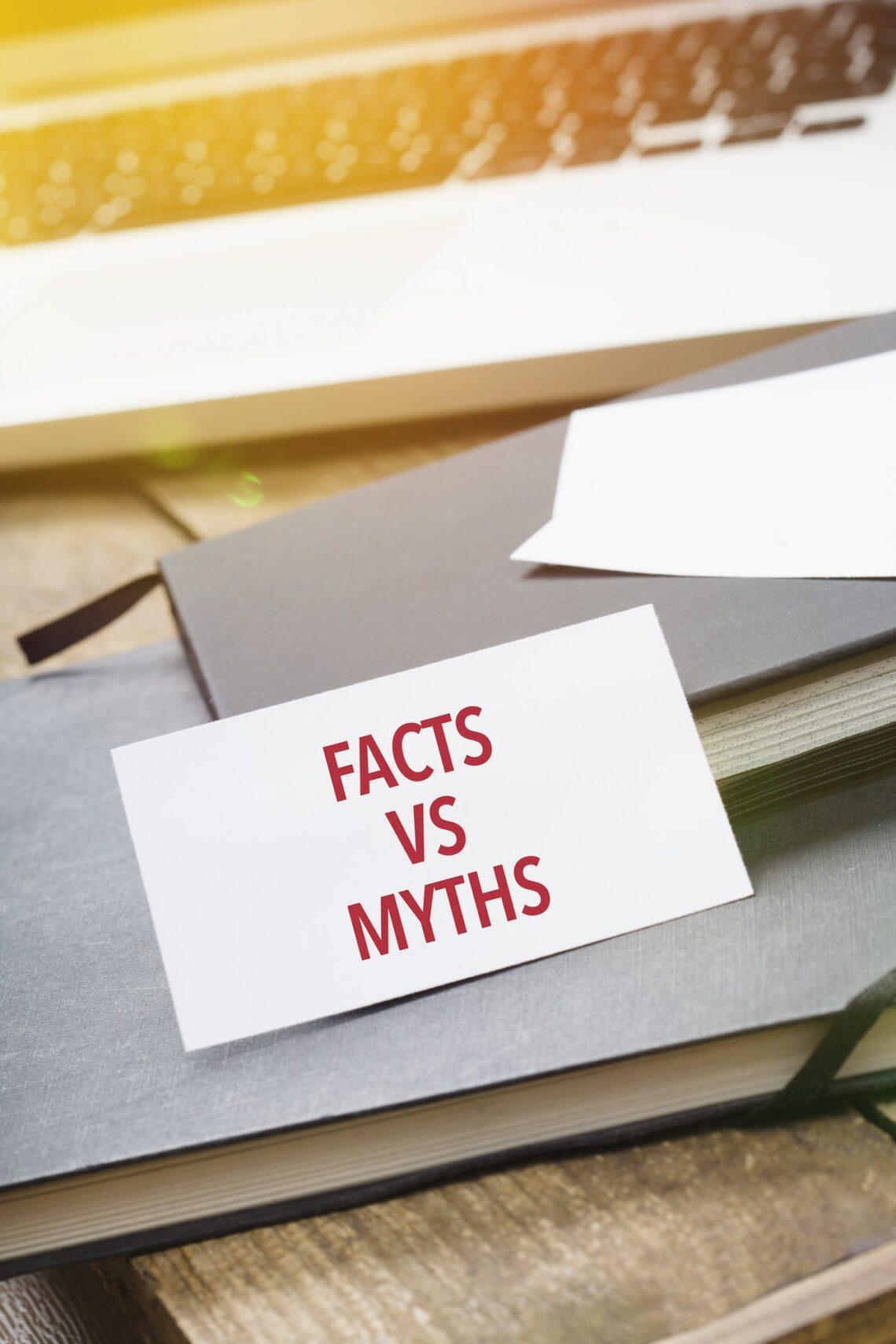 Facts vs Myths on card at office desktop