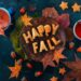 Happy fall food lettering made with cookies. Autumn flat lay with tea, sweets and fallen leaves on a